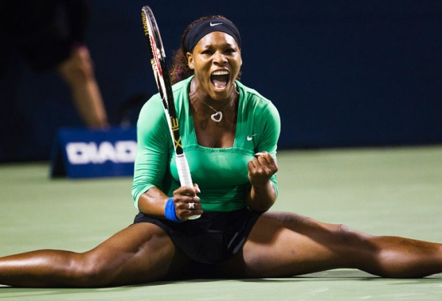 WIlliams does the splits as she celebrates a point against Zheng at the Rogers Cup women's tennis tournament in Toronto